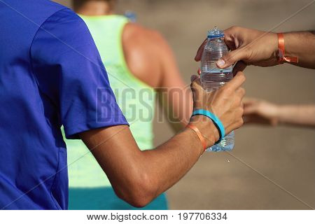 Drinks station at a trail running marathon,hydration drinking during a race