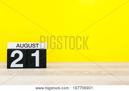 August 21st. Image of august 21, calendar on yellow background with empty space for text. Summer time.