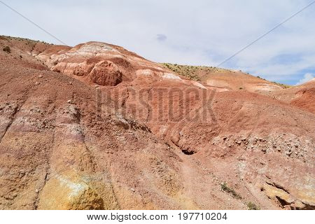 Slope of red hill. Martian landscape of Altai mountains. Altay Republic Russia.