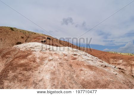 Slope of red hill. Martian view of Altai mountains. Altay Republic Russia.