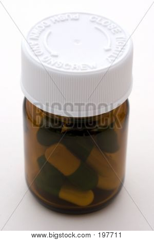 A Bottle Full Of Pills With Safety Lid