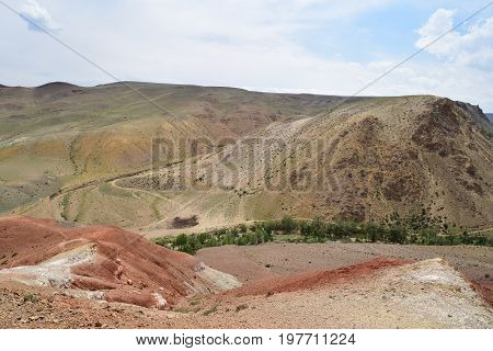 Ravine between different colored hills in Altai mountains. Altay Republic Russia.