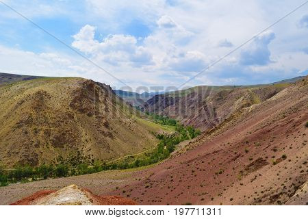 Green canyon between colorful hills in Altai mountains. Altay Republic Russia.