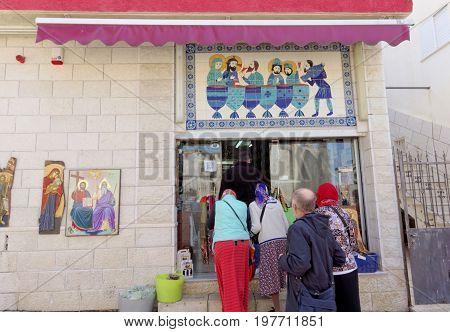Kfar Kana Israel. - February 17.2017. Pilgrims in Cana of Galilee come to the store toasting Cana wine.