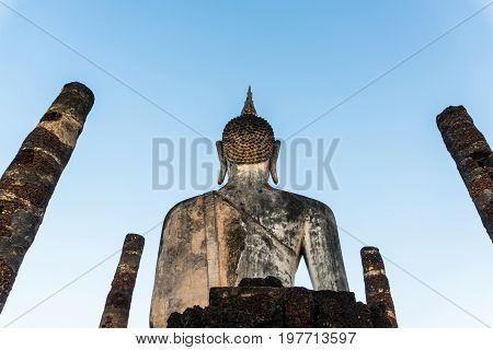 Buddha statue back at wat mahathat temple in sukhothai world heritage thailand