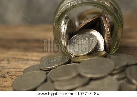 money saving concept for investment,profit,growth business and financial,web or article money management,image of coins and glass bottle close up