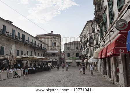 KOTOR MONTENEGRO - JUNE 30 2017: Central square in the old city of Kotor always attract tourists