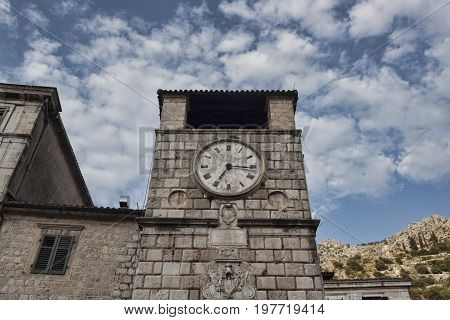 Mechanical clock at the town hall in the old town in Kotor. Summer 2017
