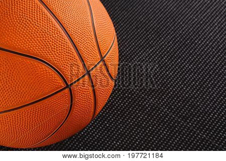 Basketball ball on black background copy space. Active game, healthy lifestyle, streetball concept