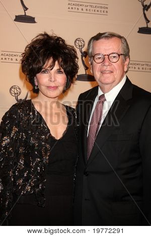 LOS ANGELES - JAN 20:  Carol Bayer Sager, Bob Daly arrives at the ATASHall of Fame Committee's 20th Annual Induction Gala at Beverly Hills Hotel on January 20, 2011 in Beverly Hills, CA