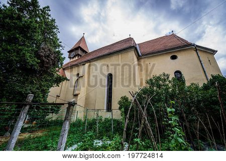 Miercurea Sibiului Romania - July 7 2017: Facade of Romanesque Saxon fortified church in Miercurea Sibiului town