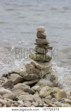 Pile Of Stones In The Balance On Sea Coast