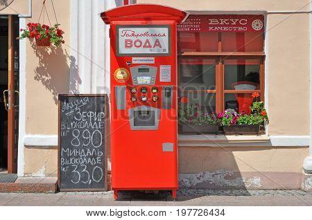 Grodno, Belarus - June 29, 2017: Vintage red soda machine on the street in Grodno.