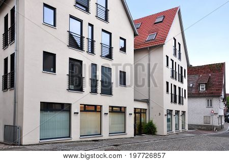 Waiblingen, Germany - April 26, 2017: Modern white residential elite low-rise houses with red tiled roof.