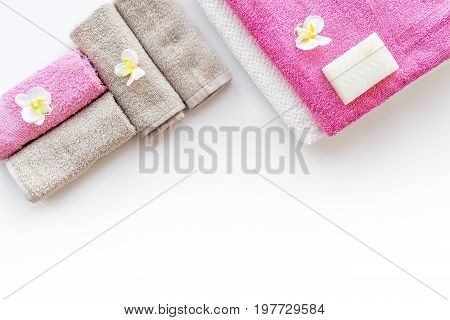 Bathroom set. Towels and soap on white backgrond top view.