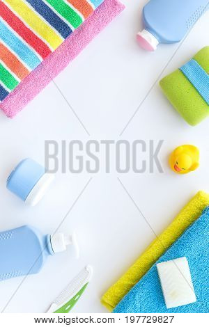 Bathroom set. Towels and bottles with soap and shampoo on white backgrond top view.