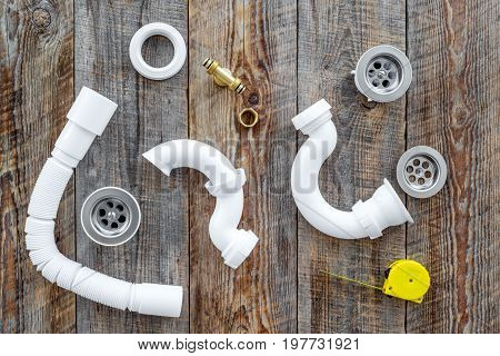 Clear clogged sink drains. Parts and tools on wooden background top view.