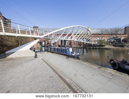 View of Castlefield Basin & the Merchant's Bridge Manchester's industrial heritage heart on a sunny morning