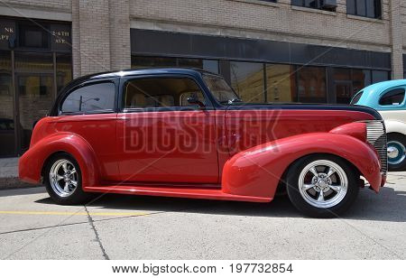 CASSELTON, NORTH DAKOTA, July 27, 2017: The annual Casselton Car Show which occurs the last Thursday of July features classic vehicles such as the  restored 1937 two door Chevy