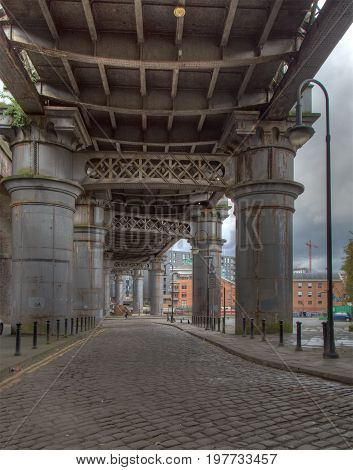 Under the huge historical Victorian Steel Rail Viaduct in Manchester