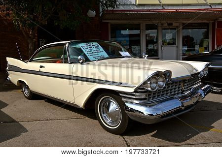 CASSELTON, NORTH DAKOTA, July 27, 2017: The annual Casselton Car Show which occurs the last Thursday of July features classic vehicles such as the  restored 1959 Plymouth Savoy