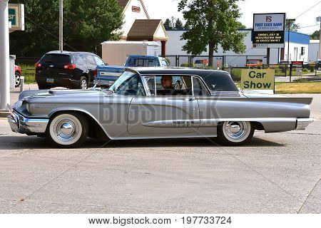 CASSELTON, NORTH DAKOTA, July 27, 2017: The annual Casselton Car Show which occurs the last Thursday of July features classic vehicles such as the  restored  1959 Ford Thunderbird