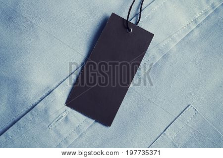 Label price tag on soft blue shirt mockup for price or brand presentation.