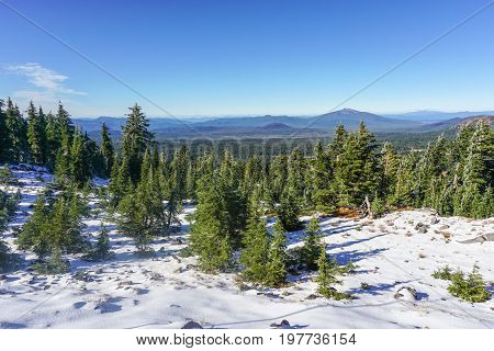 Looking back from Crater Lake to the Umpqua Forest after light snowfall