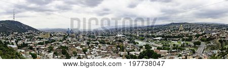 The Panoramic Top View Of Motley Historic Part Of Tbilisi, Georgia In Summer. Skyline And Beautiful Sunset Sunrise On Picturesque Sky Background Over Central Part Of The City With Famous Landmarks.
