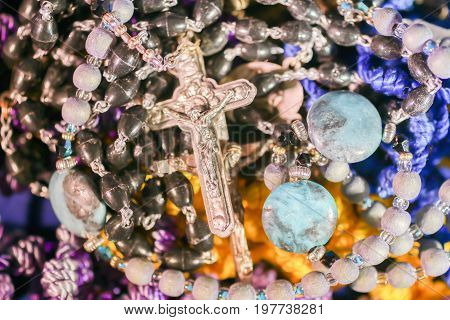 Many Beautiful Colorful Rosary Beads With Silver Crucifix