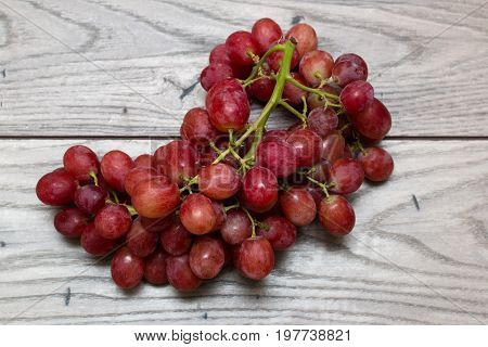 Cluster of grapes on top of a wooden table