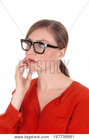 A young afraid looking woman with her hands on her face wearing black glasses standing isolated for white background