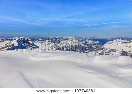 View from Mt. Titlis in Switzerland in wintertime. The Titlis is a mountain located on the border between the Swiss cantons of Obwalden and Bern, mainly accessed from the town of Engelberg on its northern side.