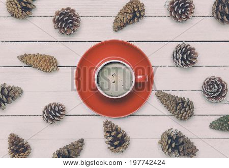 Cup Of Coffee And Pine Cone On A White Table.