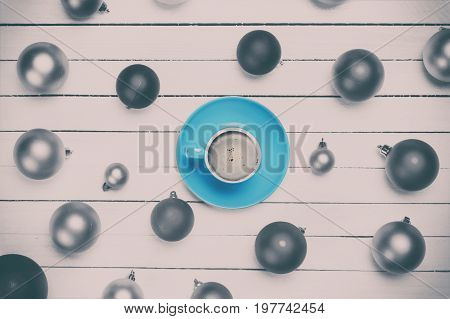 Coffee Cup And Christmas Balls On White Background.