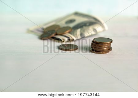 Banknotes And Coins On A White Table