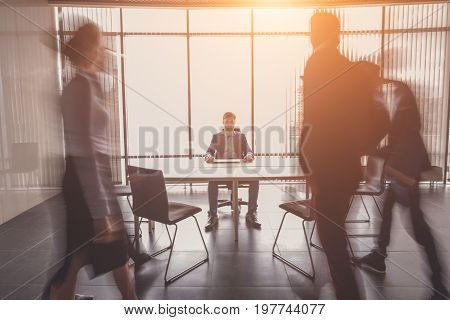 startup business young creative people group entering meeting room modern office interior and motion blur one man focused