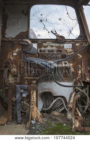 Seat In Operators Cab Of Rusting Heavy Equipment