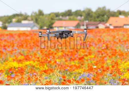 Kose-uuemoisa, Estonia - July 8, 2017: Drone Dji Mavic Pro Flying Under Poppy Field