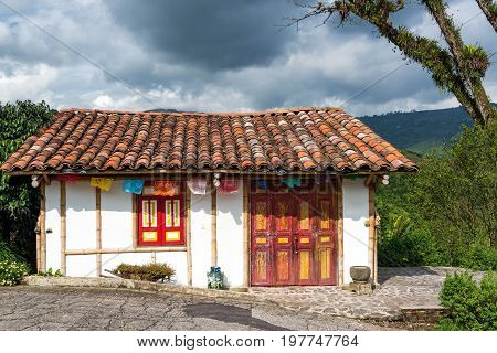 White colonial style building on a coffee plantation near Manizales Colombia