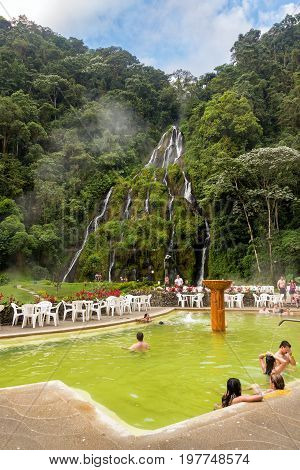 SANTA ROSA DE CABAL COLOMBIA - JUNE 2: People in the hot springs of Santa Rosa de Cabal Colombia with a waterfall in the background on June 2 2016