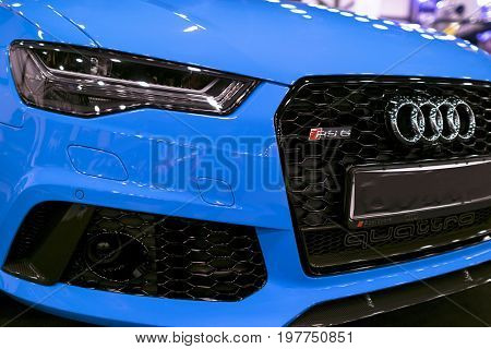 Sankt-Petersburg Russia July 21 2017: Front view of a blue modern luxury blue sport car Audi RS 6 Avant Quattro 2017. Car exterior details. Photo Taken on Royal Auto Show July 21