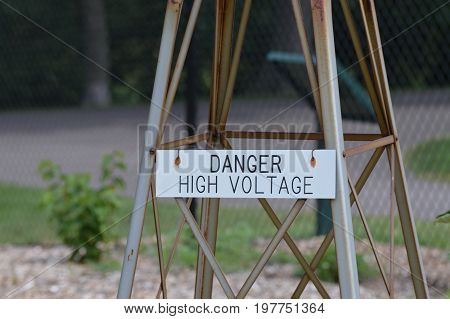 A danger high voltage warning sign at the park