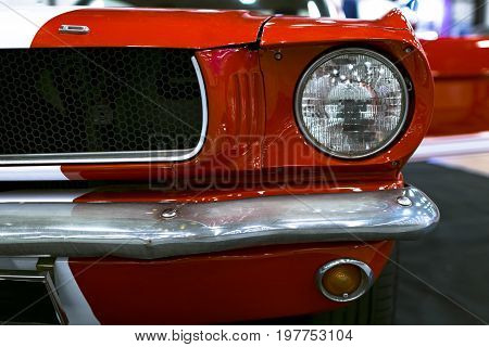 Sankt-Petersburg Russia July 21 2017: Front view of Classic retro Ford Mustang GT.Car exterior details. Headlight of a retro car. Photo Taken on Royal Auto Show July 21
