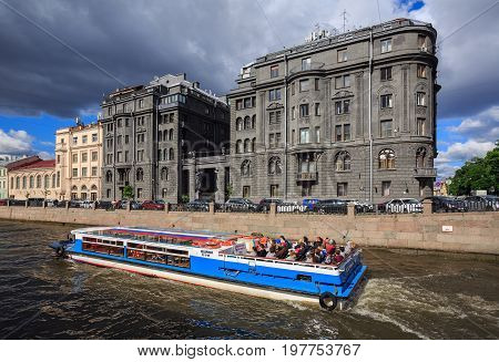 SAINT PETERSBURG/ RUSSIA - JULY 2, 2017. View of the embankment of the Krjukov canal and the Vege House (built in 1912-1914) in the foreground. Saint Petersburg, Russia.