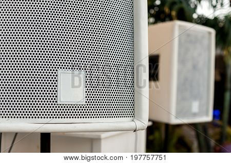 summer rest, holiday and party music concept - beautiful white hi end speakers on green tree background, concert equipment, outdoor resort entertainments., selective focus