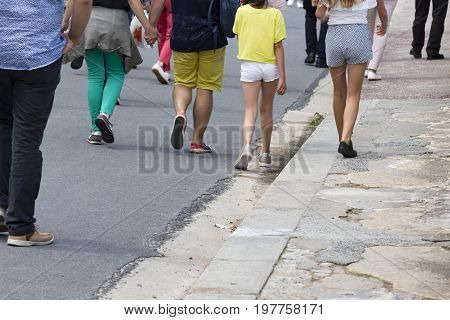people walking in the street summer clothes in France