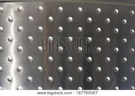 Metal plates with rivets background or texture photo