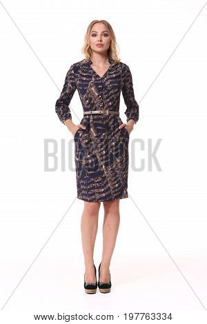 blond business woman in knee length printed formal dress high heeled shoes full body portrait isolated on white