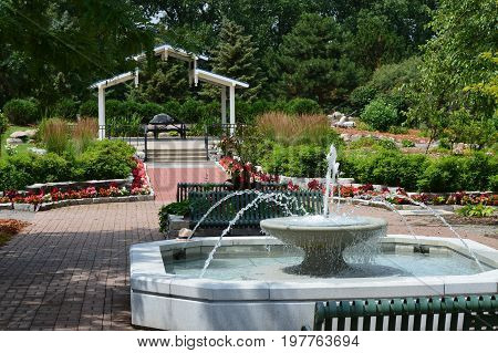 A water fountain and gazebo in the arboretum
